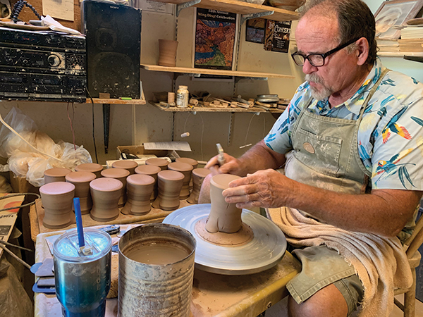 Potter Joe Bennion at the wheel shaping a stacked pot